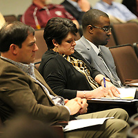 Christy Maulding of Starkville takes notes as she listens to speakers at Friday's CREATE's Dropout Prevention Summit at the Adavance Education Center on Briar Ridge Road in Tupelo.