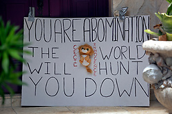 30 July 2015. Marco Island, Florida.<br /> ***NB - Image taken from inside Palmer driveway***<br /> A protest banner is taped to the front door of the  deserted Florida home of Dr Walter Palmer. The Minnesota dentist who allegedly killed Cecil the lion in Zimbabwe has gone to ground since the story broke, taking him from hunter to hunted.<br /> Photo; Charlie Varley/varleypix.com