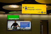 Baggage reclaim hall architecture and advertising at Heathrow's Terminal 5.
