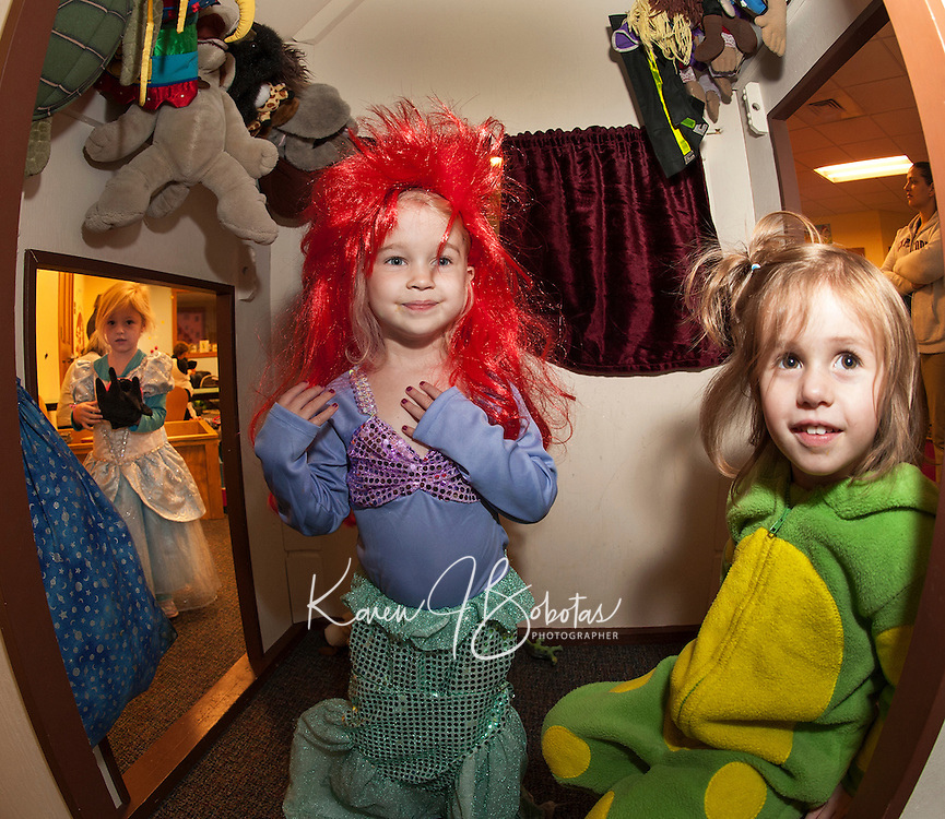 """""""Ariel the Mermaid"""" Layne O'Connor and Morgan Eastman dressed as a frog enjoy Gilford Library's annual Halloween Parade and Party on Wednesday morning.  (Karen Bobotas/for the Laconia Daily Sun)"""