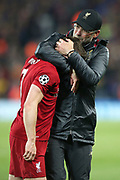 Liverpool Manager Jurgen Klopp hogs Liverpool midfielder James Milner (7) as emotion boils over after the 4-0 victory during the Champions League semi-final, leg 2 of 2 match between Liverpool and Barcelona at Anfield, Liverpool, England on 7 May 2019.