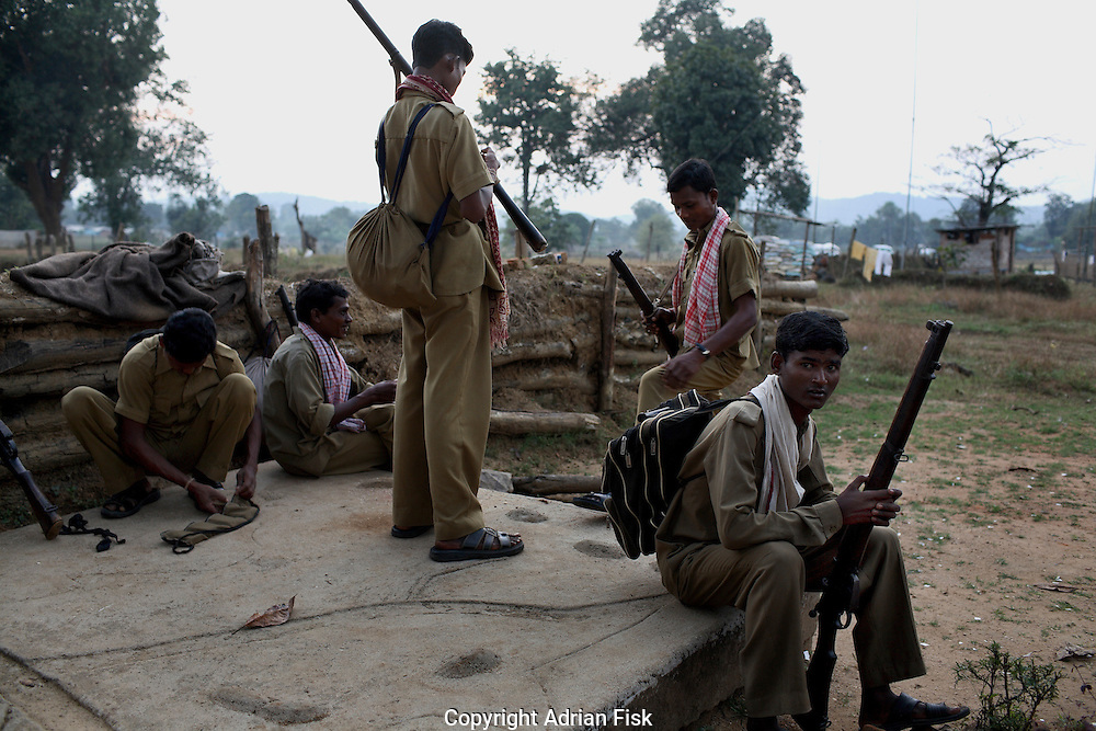 SPO's prepare for a night patrol around a Salwa Judam camp in Bastar district. Each SPO is given five rounds for their 303 rifle, a tactic that has proved dangerous for them as the Naxalites attack and wait for the SPO's to use their five rounds before attacking them with full force. The SPO's complain that the Naxalites are better equipped and trained than them.