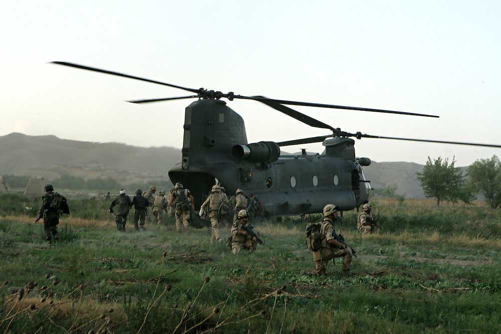 29/06/07..Sangin Valley, Helmand, Afghanistan..Wounded British and Afghan soldiers are loaded onto a Chinnok helicopter for evacuation from the frontline...Soldiers from A Company 1 Battalion Royal Anglians, known as 'The Vikings' conduct operations against the Taliban in the Sangin Valley, Helmand province, Afghanistan on the 29th June 2007...The soldiers made a Tactical Advance to Battle over night carrying just food, water and ammunition. At first light they moved on their objectives; a series of compounds, orchards and paddy fields. During the day they exchanged fire with the enemy on a number of occasions. 13 Taliban were killed, 1 British soldier and 3 Afghan troops were wounded.