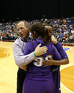 Weimar girls basketball coach Roger Maupin shares a celebratory hug with seniors Hunter Ervin (33) and Jazmine Kirby (21) on the court of the Alamodome in San Antonio after the Lady Cats beat Panhandle 52-47 to win the school's first-ever girls state basketball title on Saturday, March 5, 2016.
