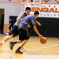 110413    Brian Leddy<br /> Joe Yazzie keeps a tight guard on his opponent during practice at Gallup High School. Monday marked first day of practice for the Gallup boys basketball team.