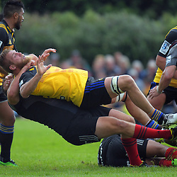 Joe Moody takes Brad Shields out of a ruck during the Super Rugby preseason rugby union match between the Hurricanes and Crusaders at Border Rugby club in Waverley, New Zealand on Friday, 17 February 2017. Photo: Dave Lintott / lintottphoto.co.nz