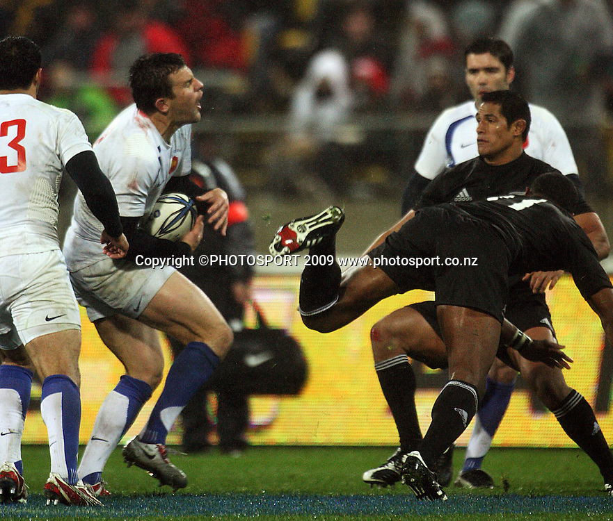 French second five Damien Traille beats Joe Rokocoko to a high ball as Tanerau Latimer (right) closes in.<br /> International Test Match - All Blacks v France, Westpac Stadium, Wellington. Saturday 20 June 2009. Photo: Dave Lintott/PHOTOSPORT