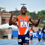 UTEP's Jonah Koech (#410) raises his hands in vitcory in the Men's 800 meter dash at the 2017 CUSA Track and field meet, Finals Kidd Field El Paso Texas