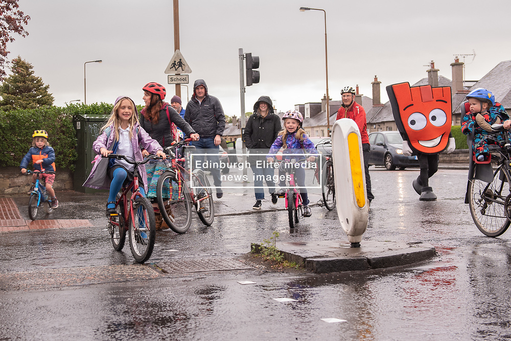 Spokes Porty, the local Spokes group in Portobello, organised a Safe Routes to School event this morning for primary school children in Portobello, Edinburgh. They were joined on the school run by local MSP, Ash Denham, local councillors Mary Campbell and Maureen Child and Strider, the Living Streets Scotland mascot. The 'walking bus' made its way from Portobello High Street vis St Johns Primary School to finish at Duddingston Primary School where participants could get some breakfast!<br /> <br /> <br /> © Jon Davey/ EEm