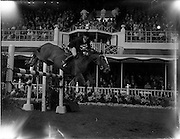 04/08/1960<br /> 08/04/1960<br /> 04 August 1960<br /> R.D.S Horse Show Dublin (Thursday). Captain the Honourable John Brooke riding &quot;Tyrenny&quot; owned by the Honorable Mrs Brooke, clearing a pole jump in the International Jumping Competition for the Boylan Memorial Perpetual Challenge Trophy at the Dublin Horse Show.
