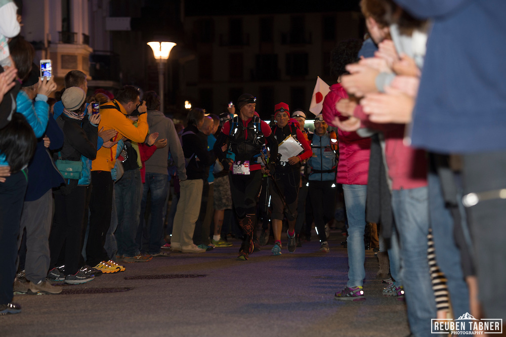 Crowds cheer on teams at the start of the UTMB PTL (La Petite Trotte a Leon) Race. The PTL starts and ends in Chamonix, and takes runners on a 300km tour of the Alps, with over 24,000 meters of ascent. It must be completed by the teams of 2 or 3 runners within 138hours.