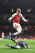 Arsenal Forward Emile Smith-Rowe (55) and Sporting Lisbon Defender Jeremy Mathieu (22) during the Europa League group stage match between Arsenal and Sporting Lisbon at the Emirates Stadium, London, England on 8 November 2018.