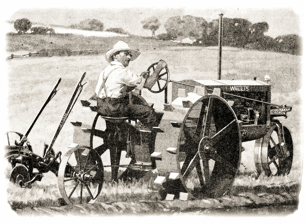 Historic illustration of farmer riding a Wallis tractor from early 20th century.