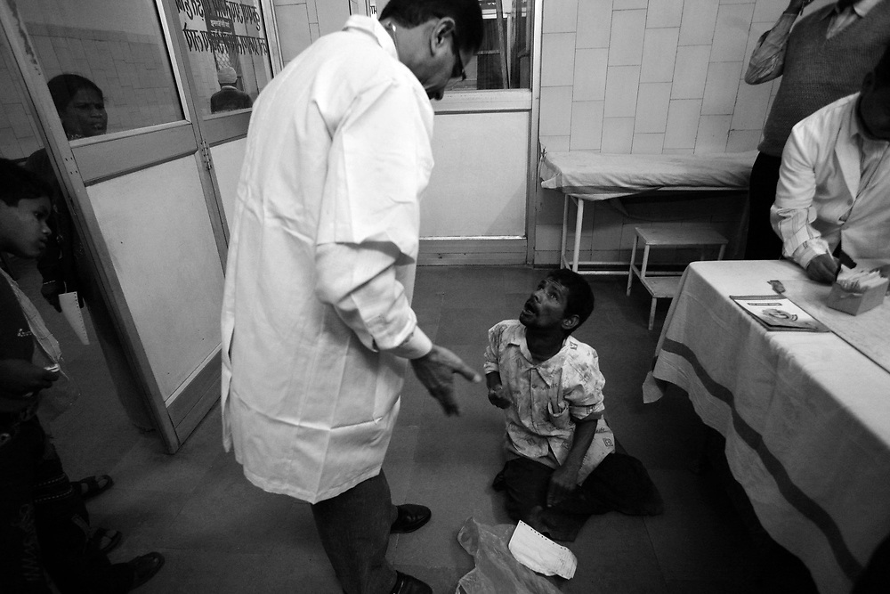 At the government-run DIG hospital, medical officer Dr. Malik, says they treat more than 1700 patients in any 24-hour period.&quot;There are not enough doctors,&quot; says child specialist Dr. Pradeep Shasna who works 6-days a week at DIG. &quot;We give medications and refer bigger cases to the Bhopal Memorial Hospital and Research Centre&quot;.<br /> The BMHRC was built with funds provided by Union Carbide to give specialist treatment to all gas victims, however, few seem to get the help they need. Hemant, who has kidney failure, was turned away from the emergency room because the doctors were on holiday and a couple of days later he was admitted, but told<br /> he needed to bring in his own blood. Six-months-earlier, <br /> Mushtaq Ahmed died on the BMHRC waiting room <br /> floor because the hospital wouldn&rsquo;t admit him.