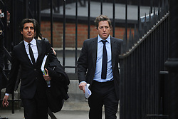 © London News Pictures. 21/11/2011. London, UK.  L to R David Sherborne QC and actor Hugh Grant arriving at The Royal Courts of Justice today (21/11/2011) to give evidence at the Leveson Inquiry into press standards. The inquiry is being lead by Lord Justice Leveson and is looking into the culture, and practice of the UK press. The Leveson inquiry, which may take a year or more to complete, comes after The News of The World Newspaper was closed following a phone hacking scandal. Photo credit : Ben Cawthra/LNP