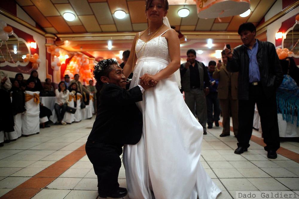 Crescencio Choque and his wife Isabel Lorena dance a waltz as they celebrate their marriage  in La Paz, Saturday, Dec. 19, 2009.