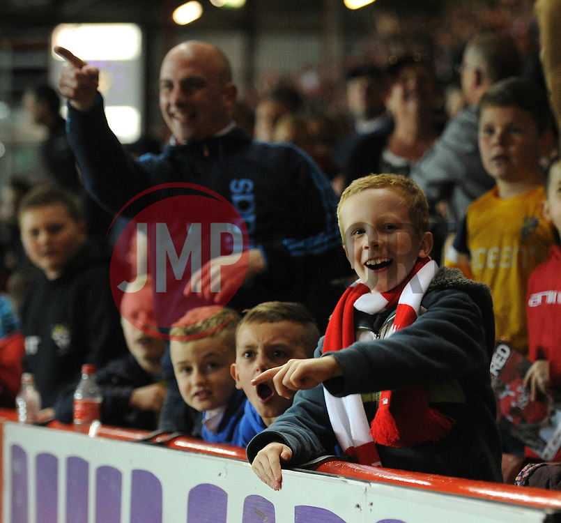 Bristol City fans celebrate - Photo mandatory by-line: Dougie Allward/JMP - Mobile: 07966 386802 - 07/04/2015 - SPORT - Football - Bristol - Ashton Gate - Bristol City v Swindon Town - Sky Bet League One
