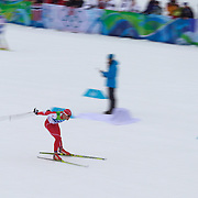 Winter Olympics, Vancouver, 2010.Dario Cologna, Switzerland,winning Gold in the Men's 15km Cross Country Skiing event at The Whistler Olympic Park, Whistler, during the Vancouver Winter Olympics. 14th February 2010. Photo Tim Clayton