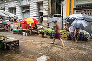 12 JUNE 2013 - YANGON, MYANMAR:   People walk through a rainy season thunderstorm in Yangon, Myanmar.       PHOTO BY JACK KURTZ