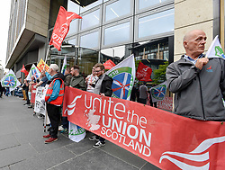 Campaigners from the Ready for Renewal campaign picketed the Edinburgh offices of energy firm EDF, to demand answers on their decision to have wind turbine jackets built in Indonesia rather than idle Fife yards that are only ten miles from the firm's proposed wind farm site.<br /> <br /> © Dave Johnston / EEm