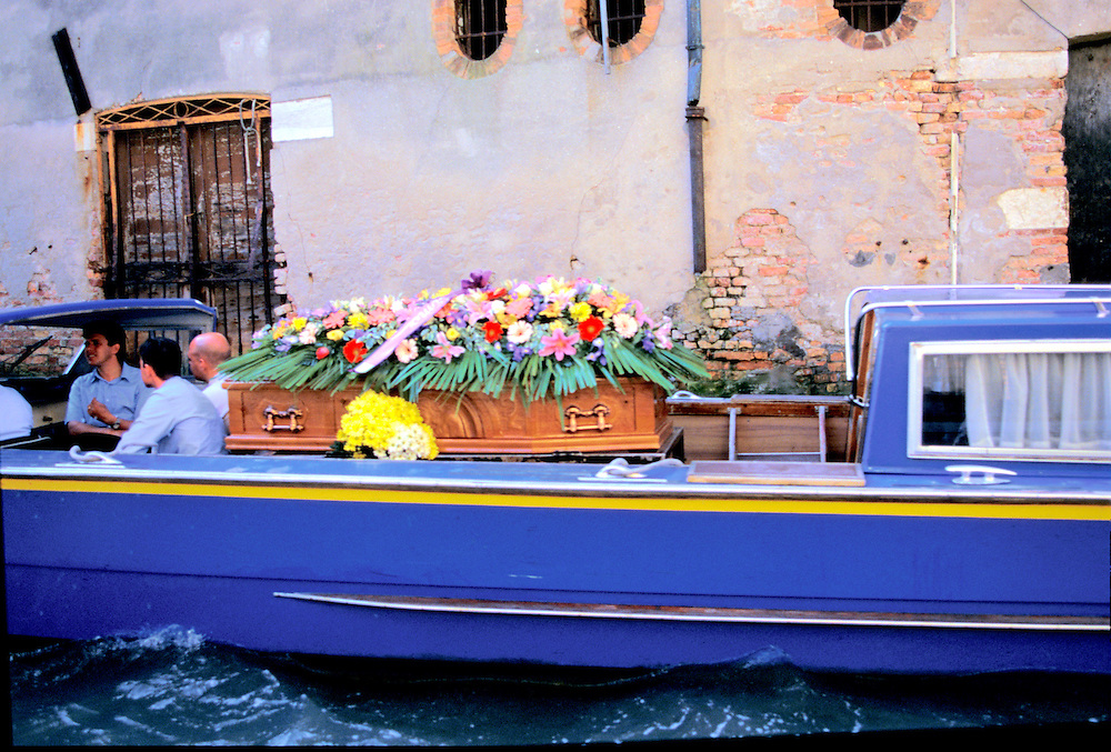 Venice, Italy:  Even coffins, mourners, and funeral processions go via gondola in Venice.