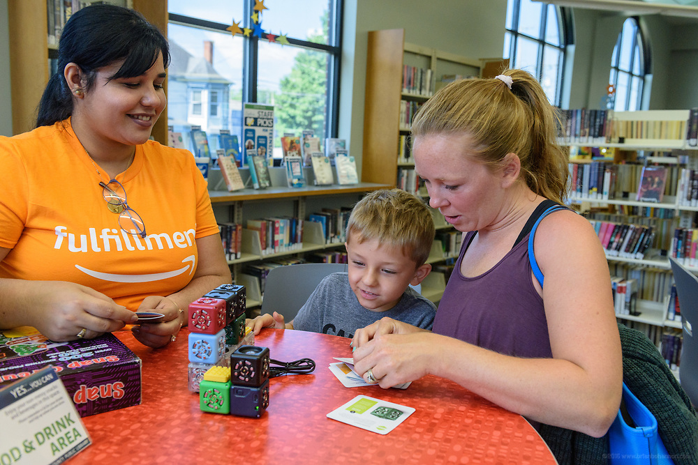 Leaders from Amazon present a donation of $10,000 in new technology to support Bullitt County Library's STEM and STEAM programs for students in the Bullitt County School District Tuesday, July 10, 2018 at the Ridgway Memorial Library in Shepherdsville, Ky. The donation will enhance the library's current Digital Tech and Makerspace Lab programs and ignite more students to take advantage of STEM education outside of the classrooms and included Oculus Go headsets, a Cubelets classroom, and several sets of LEGOs that will increase the lab's ability to help students learn and explore STEM. (Photo by Brian Bohannon)