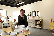 27 September 2012-  MJ Zaremba, owner, is photographed at Pot & Ladle, consignment kitchen store in Omaha, Nebraska