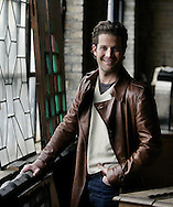 Decoration guru Nate Berkus looks over items at Salvage One in Chicago..