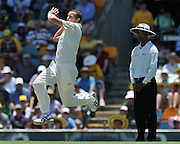 "Peter Siddle bowling from the Vulture Street end before lunch on Day 2 of the 1st Test in the 2013-14 Ashes Cricket Series between Australia and England at the GABBA (Brisbane, Australia) from Thursday 21st November 2013<br /> <br /> Conditions of Use : NO AGENTS ~ This image is subject to copyright and use conditions stipulated by Cricket Australia.  This image is intended for Editorial use only (news or commentary, print or electronic) - Required Image Credit : ""Steven Hight - AURA Images"""