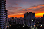 THAILAND, Bangkok: 09 November 2015 A beautiful sun rise this morning casts light across the city of Bangkok, Thailand. Rick Findler / Story Picture Agency