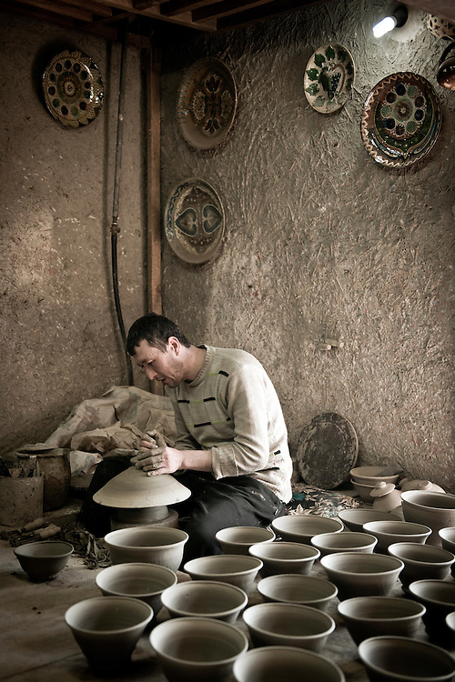 Gijduvan, Uzbekistan 22 March 2012. A ceramist works at Abdullo Narzullaev's workshop.