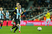 Mark Sykes (#18) of Oxford United pulls back Miguel Almiron (#24) of Newcastle United giving away a free kick during the The FA Cup match between Newcastle United and Oxford United at St. James's Park, Newcastle, England on 25 January 2020.