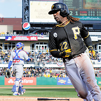 Pittsburgh Pirates center fielder Andrew McCutchen (22) crosses the plate for the  Pirates only run in their home opener during the ninth inning of the 3-1 lost to the Chicago Cubs at PNC Park in Pittsburgh, on April 1, 2013.  UPI/Archie Carpenter