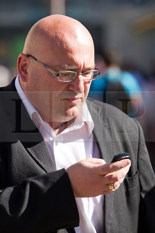 """© Licensed to London News Pictures . FILE PICTURE DATED 08/09/2012 .  Manchester , UK . DOMENYK NOONAN (pictured in Manchester City Centre on 8th September) has been remanded in custody . He is accused of raping a 15 year old boy . He appeared at Manchester Crown Court via videolink from Manchester prison , charged with four counts of rape and false imprisonment . Police were called to a flat in Manchester City Centre on the afternoon of Wednesday (24th October) . The organised crime boss and star of documentary """"At Home With the Noonans"""" also goes under the name Lattlay-Fottfoy .  He is a cousin of Mark Duggan , whose shooting sparked off riots in London in the summer of 2011 . Photo credit : Joel Goodman/LNP."""