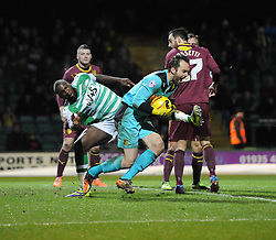 Yeovil Town's Ishmael Miller challenges Watford's Manuel Almunia for the ball - Photo mandatory by-line: Joe Meredith/JMP - Tel: Mobile: 07966 386802 18/02/2014 - SPORT - FOOTBALL - Yeovil - Huish Park - Yeovil Town v Watford - Sky Bet Championship