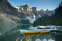 Colorful canoes on dock of Moraine Lake, Banff National Park Alberta Canada