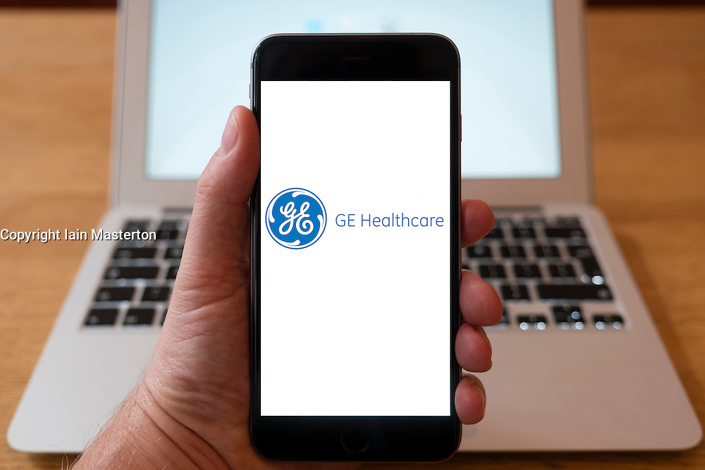 Using iPhone smartphone to display logo of GE Healthcare;