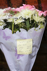 © Licensed to London News Pictures. 19/05/2016. London, UK. Flowers and a note left outside a property at the Maitland Park Estate in Hampstead, North London, where the body of a woman in her 40s was found.   A murder investigation has been launched. Photo credit: Ben Cawthra/LNP