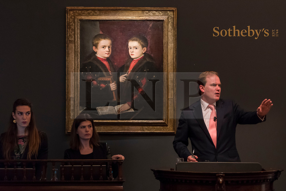 """© Licensed to London News Pictures. 07/12/2016. London, UK. """"Portrait of Two Boys, said to be members of the Pesaro Family"""" by Tiziano Vecellio, called Titian and workshop sold for a hammer price of GBP 1.175m (est. GBP 1-1.5m) at the Old Masters Evening Sale at Sotheby's in New Bond Street. Photo credit : Stephen Chung/LNP"""