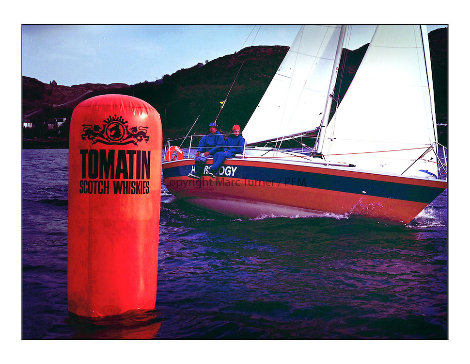 The Clyde Cruising Club's 1977 Tomatin Trophy the first Scottish Series held at Tarbert Loch Fyne.  An overnight race from Gourock to Campbeltown then on to Olympic Triangles in Loch Fyne. <br /> <br /> Branded Tomatin Mark with K5526 Hydrology, F. Olsens Hydro.<br /> <br /> <br /> Picture Copyright  PFM Pictures
