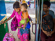 25 NOVEMBER 2017 - YANGON, MYANMAR: Passenger board the Yangon Circular Train in Yangon Central Station. The Yangon Circular Train is a 45.9-kilometre (28.5 mi) 39-station two track loop system connects satellite towns and suburban areas to downtown. The train was built during the British colonial period, the second track was built in 1954. Trains currently run both directions (clockwise and counter-clockwise) around the city. The trains are the least expensive way to get across Yangon and they are very popular with Yangon's working class. About 100,000 people ride the train every day. A a ticket costs 200 Kyat (about .17¢ US) for the entire 28.5 mile loop.    PHOTO BY JACK KURTZ