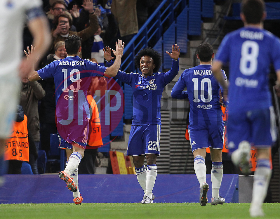 Willian ( 2nd L )  of Chelsea celebrates after scoring to make it 2-0 - Mandatory byline: Paul Terry/JMP - 09/12/2015 - Football - Stamford Bridge - London, England - Chelsea v FC Porto - Champions League - Group G