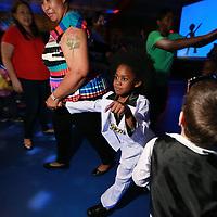 Travarious Burnett, 5, struts down the dance floor with his mother, Towana, at Thursday 70's disco night at Joyner Elementary School.