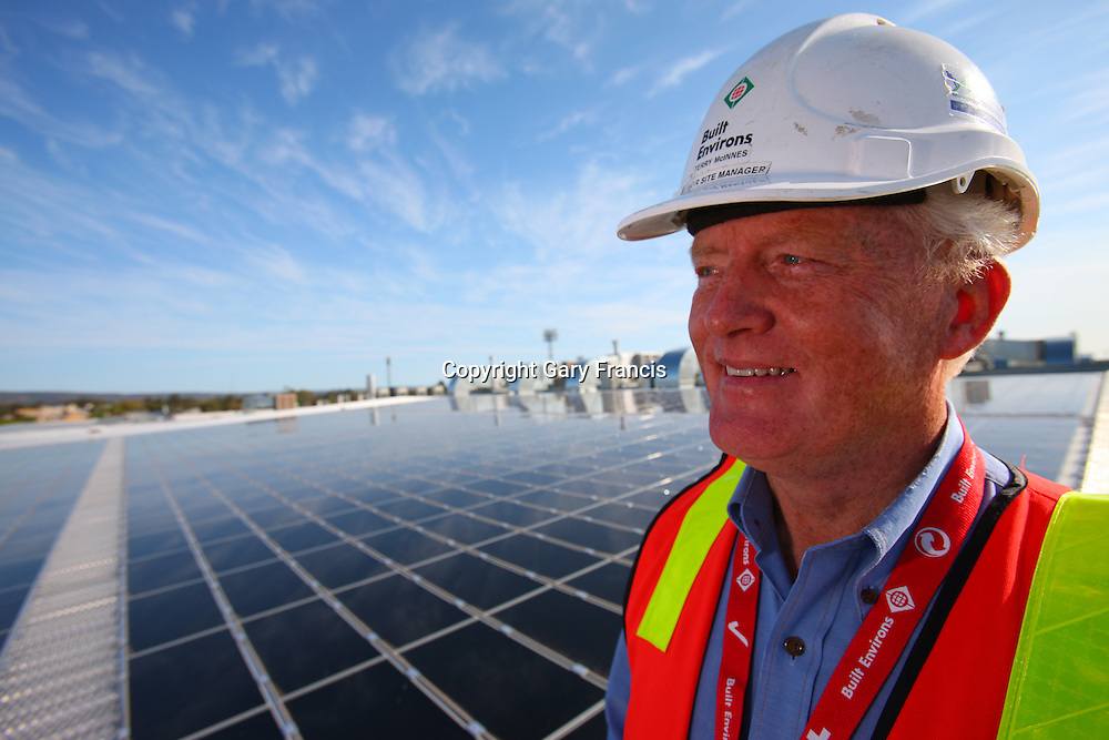 Terry McInnes, Site Manager for Built Environs on the roof of the Goyder Pavillion where the major of the Solar installation is located,  Adelaide, South Australia