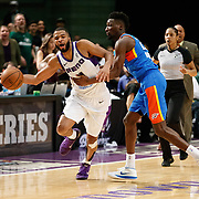 Reno Bighorns Guard AARON HARRISON (1) obstructed by Oklahoma City Blue Guard DANIEL HAMILTON (25) during the NBA G-League Basketball game between the Reno Bighorns and the Oklahoma City Blue at the Reno Events Center in Reno, Nevada.
