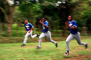 024221.SP.0115.dodgers4.kc--Guerra, Dominican Republic--Pitchers do wind sprints as part of their afternoon workouts at Dodgers Campos Las Palmas. This is the resort like baseball Academy where players get their chance to become professional baseball players. The overall atmosphere is very plush, where workers wear the Dodgers logo and every field meticulously manicured.  The players are living a life far different from their upbringing for many of the young players this is a chance of a lifetime.