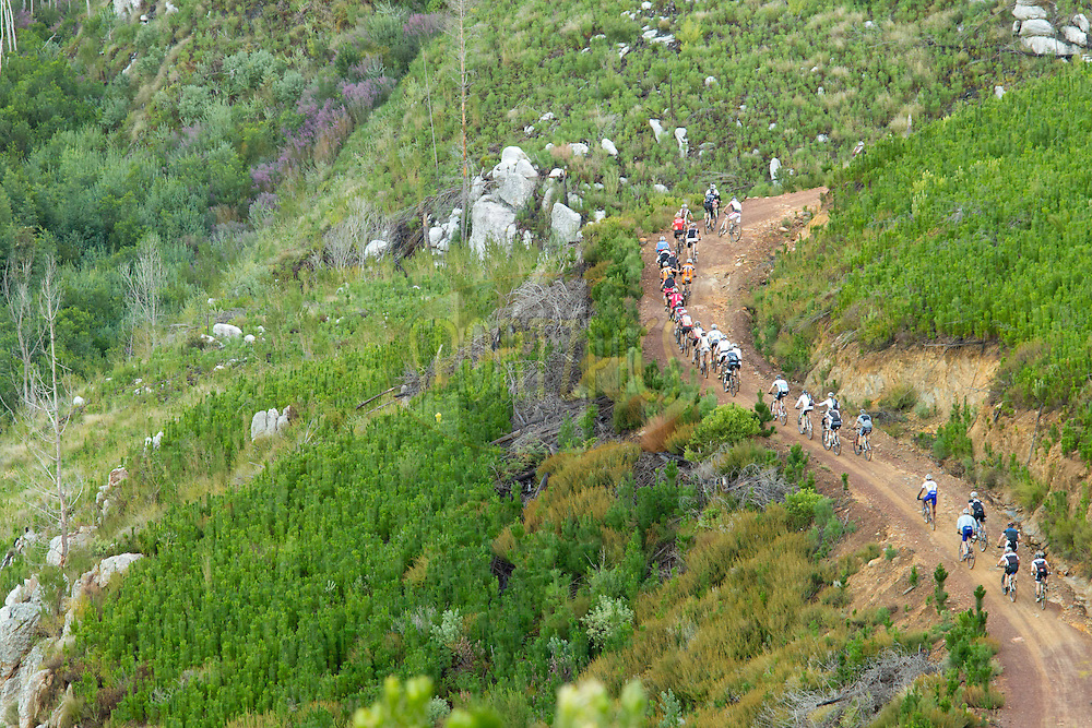 Riders climbing Nieuweberg during stage 6 of the 2012 Absa Cape Epic Mountain Bike stage race held in and around Oak Valley Wine Estate in the Elgin Valley, South Africa on the 31 March 2012..Photo by Greg Beadle/Cape Epic/SPORTZPICS