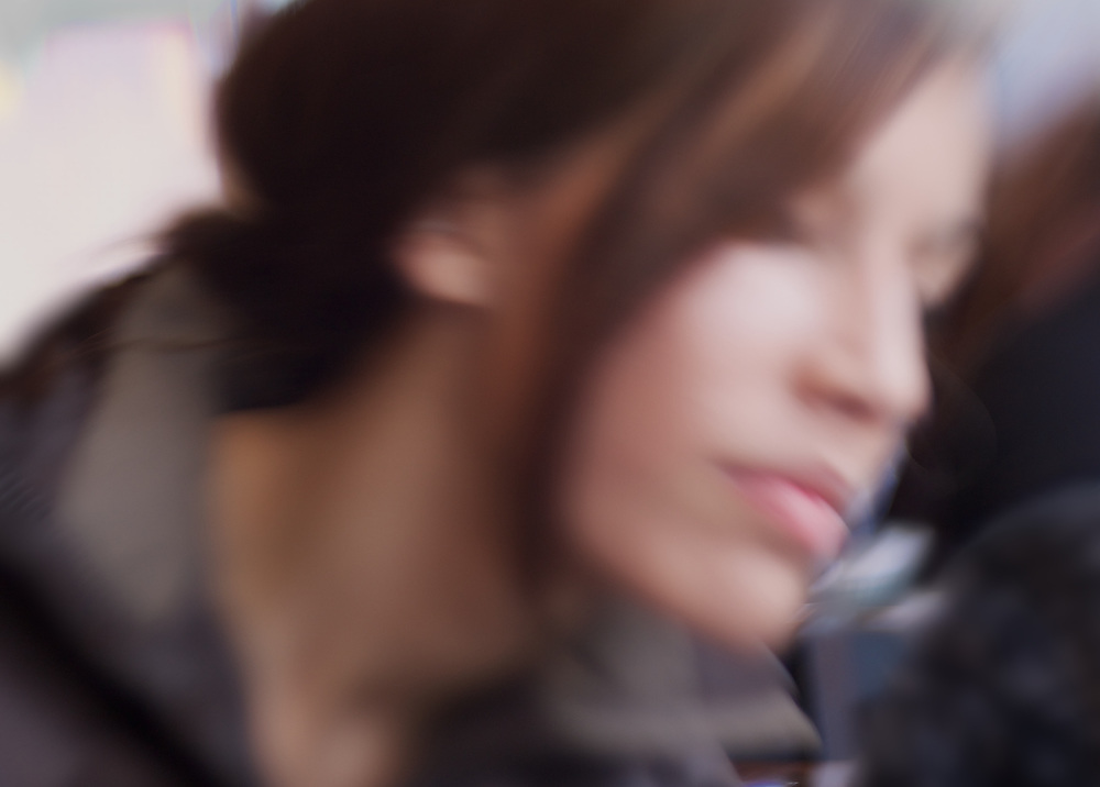 Beautiful woman's portrait rendered with intentional camera movement.