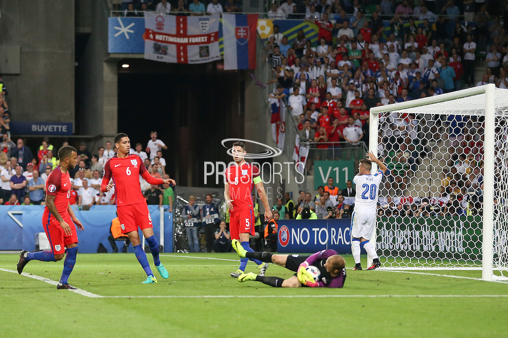 England Goalkeeper Joe Hart saves and Slovakia Midfielder Robert Mak missed chance during the Euro 2016 Group B match between Slovakia and England at Stade Geoffroy Guichard, Saint-Etienne, France on 20 June 2016. Photo by Phil Duncan.