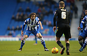 Brighton defender, full back, Inigo Calderon (14) blocks the path for Bolton Wanderers midfielder, Josh Vela (6) during the Sky Bet Championship match between Brighton and Hove Albion and Bolton Wanderers at the American Express Community Stadium, Brighton and Hove, England on 13 February 2016.